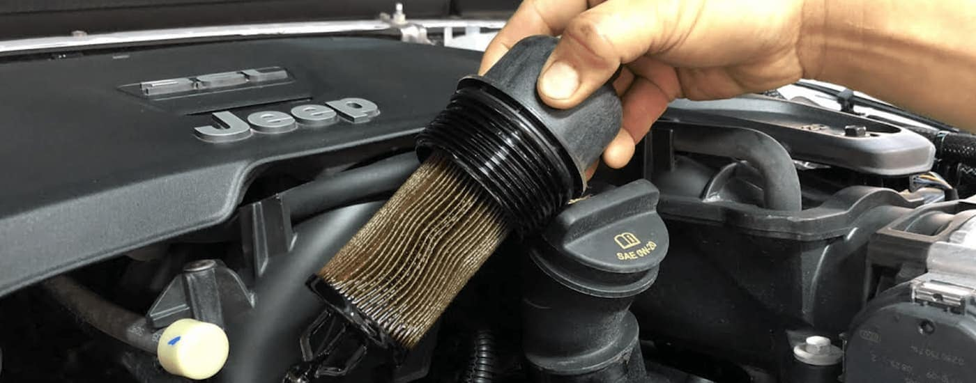 A Jeep gets a air filter change at a local Jeep Service center