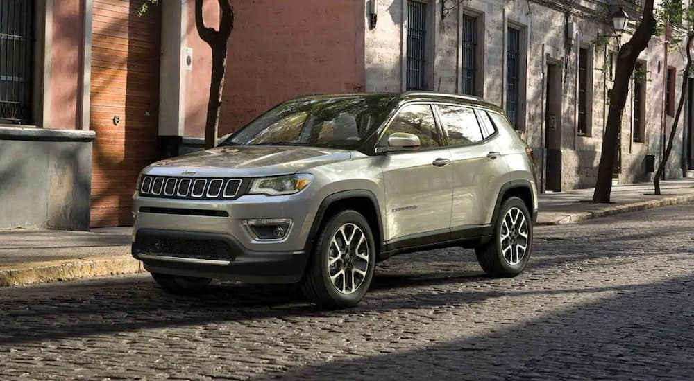 A silver 2019 Jeep Compass on a city street