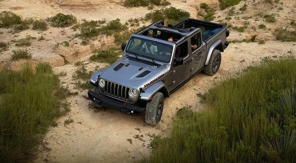 A grey 2020 Jeep Gladiator is off roading in Colorado Springs, CO.