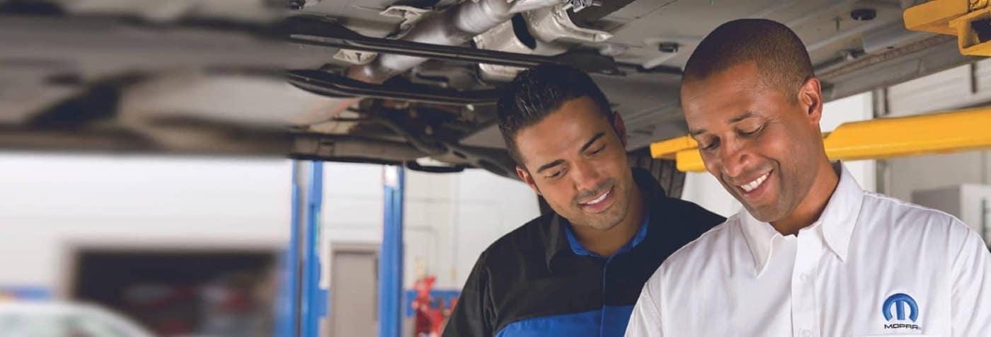 A pair of technicians at a local dealer