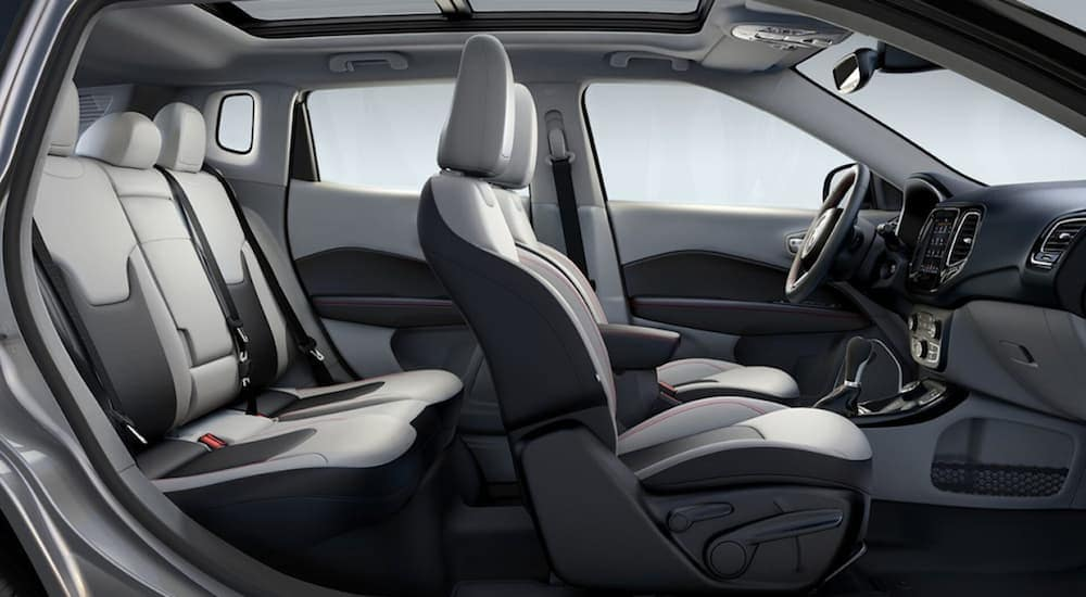 A side view of the black and white leather interior found inside of a 2020 Jeep Compass is shown.