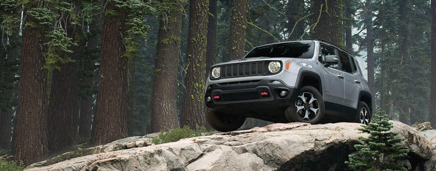 A silver 2019 Jeep Renagade is parked on rocks while off-roading near Colorado Springs, CO.