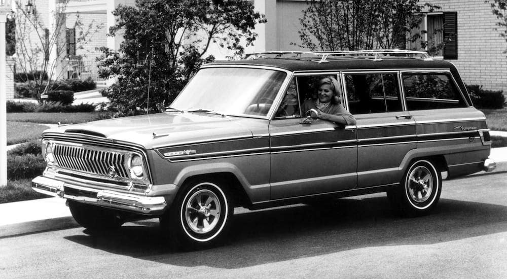 A black and white photo of a classic Jeep model for Colorado Springs, a 1966 Jeep Wagoneer.