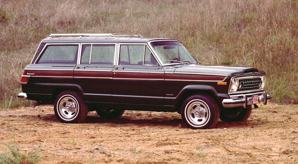 A 1978 Jeep Wagoneer is parked in a field.