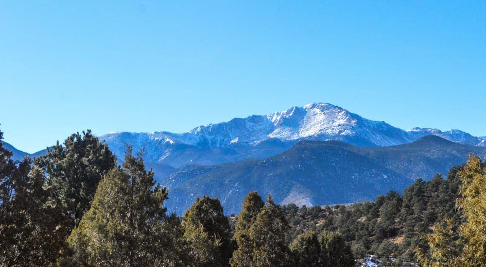 Pikes Peak is shown with blue skies.