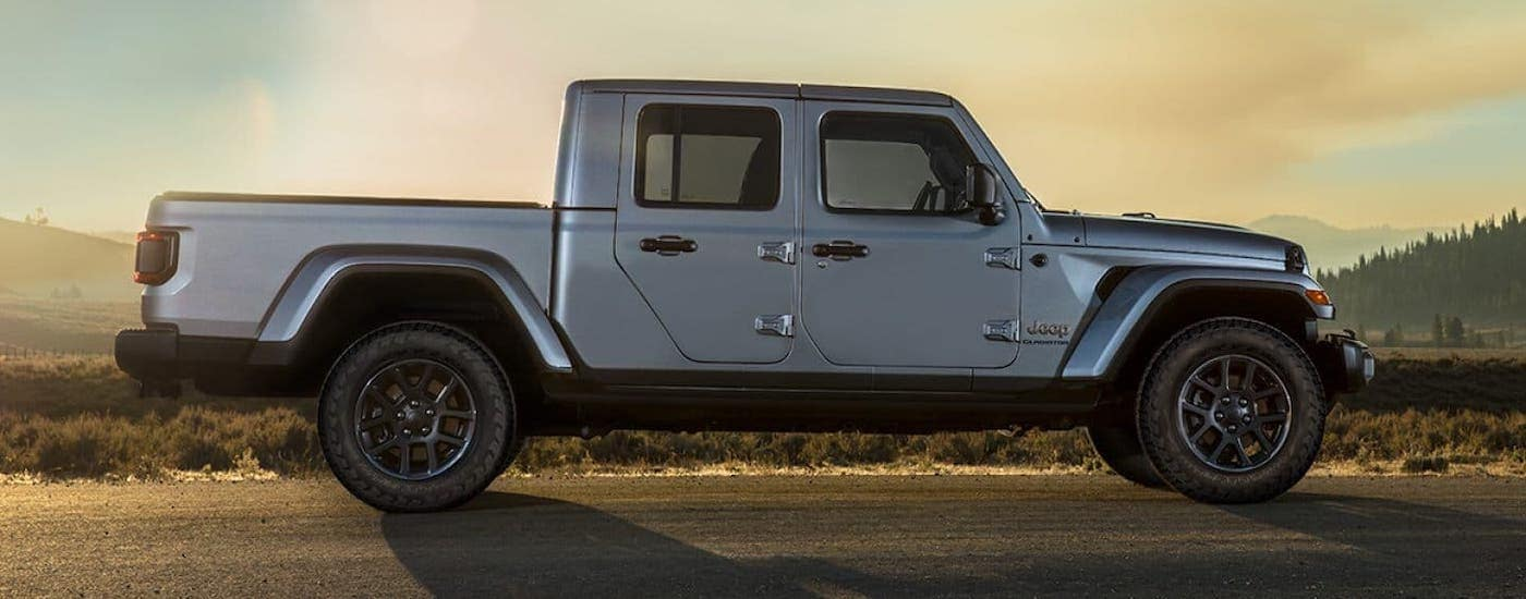 A silver 2020 Jeep Gladiator is in a desert and shown in profile.