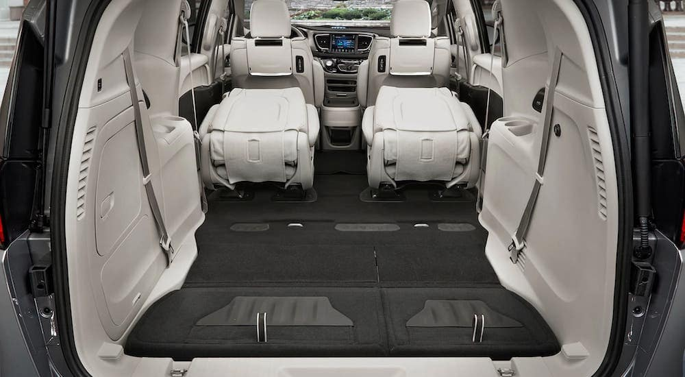 The cargo area of a 2018 Chrysler Pacifica is shown with the third row of seats removed.