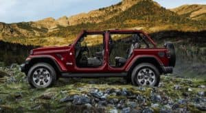 A burgundy 2021 Jeep Wrangler Unlimited is shown from the side with no doors or roof.