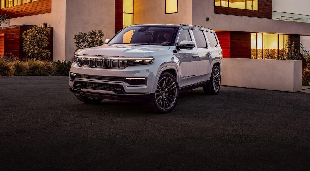 A resurrected Jeep model, a white 2021 Jeep Grand Wagoneer concept, is parked in front of a home in Colorado Springs, CO.