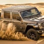 A grey 2021 Jeep Gladiator Mojave Edition is off-roading in the sand.