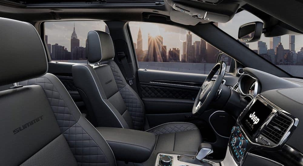 The black leather interior is shown on 2021 Jeep Grand Cherokee Summit.