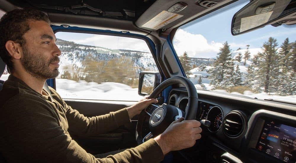 A popular Jeep model, the 2021 Jeep Gladiator Overland is being driven through the snow.
