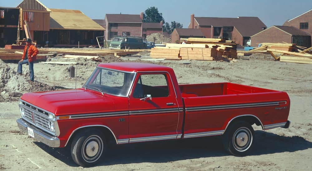 A red 1975 used Ford-F-150 Ranger XLT is parked in the middle of a construction site.