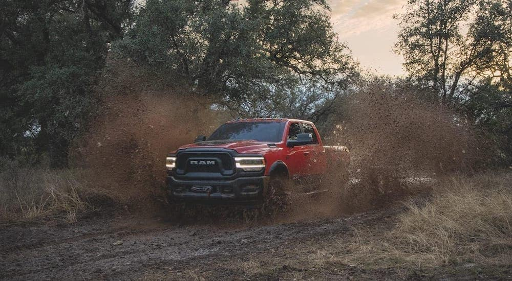 A red 2019 Ram 2500 Power Wagon is kicking up mud.