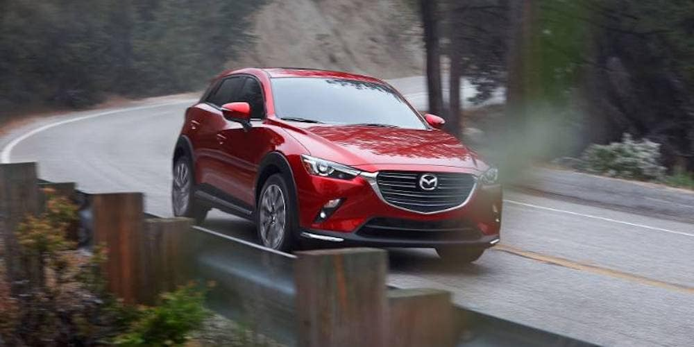 red 2019 cx-3 on highway turn