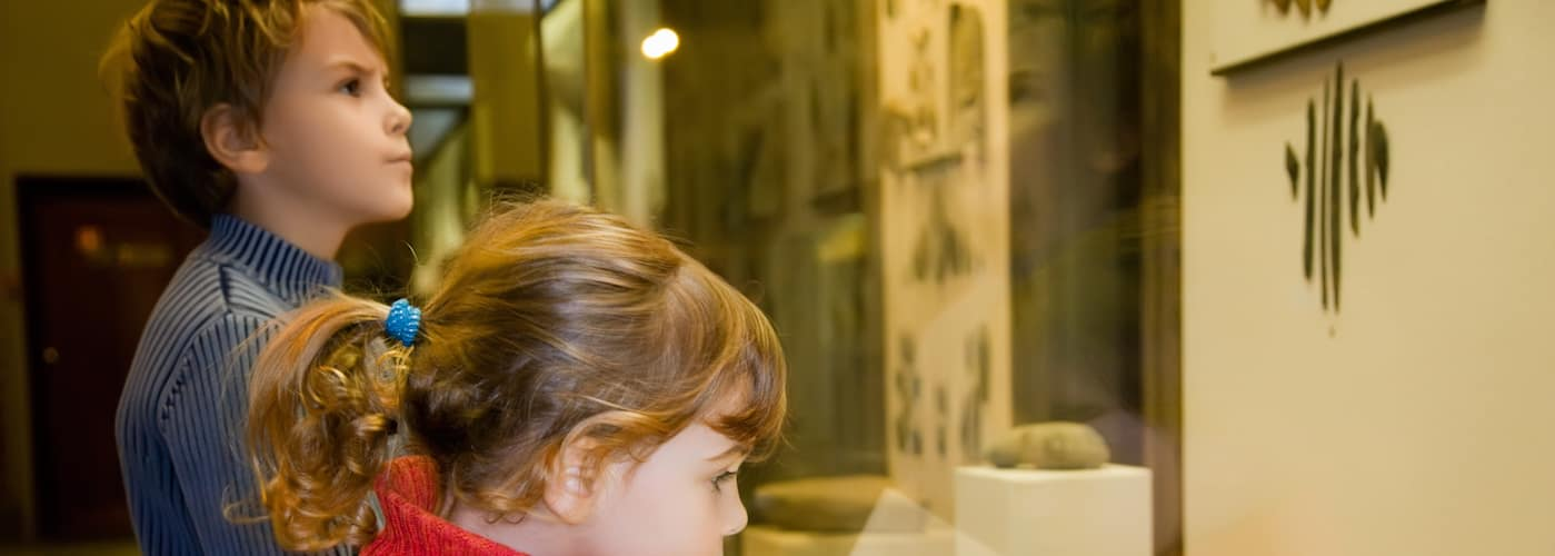 young boy and girl in historical museum