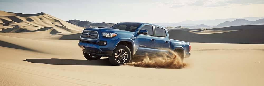 Toyot Tacoma driving in the sand