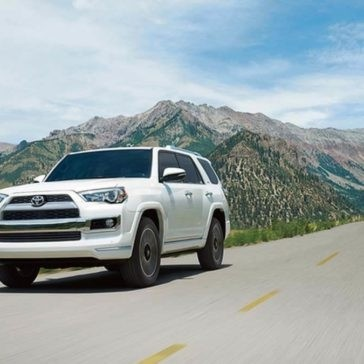2017 Toyota 4 Runner driving down a road