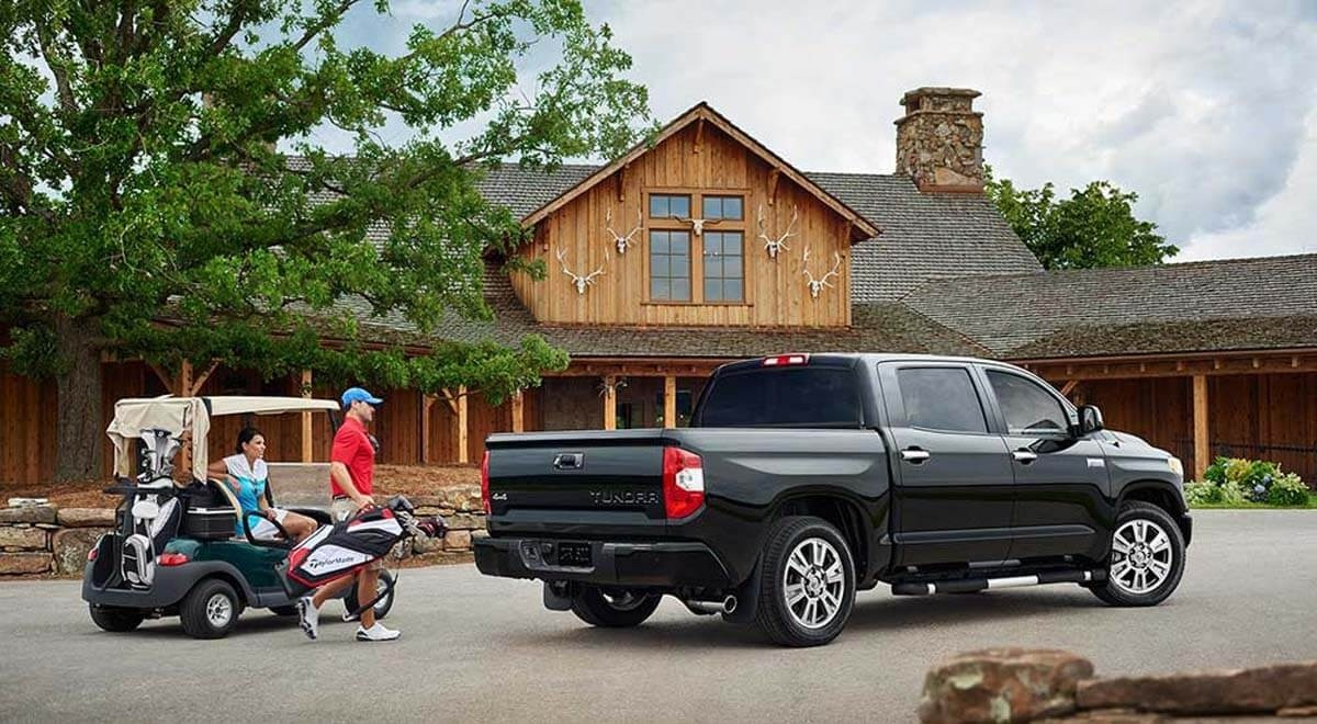 Guys loading golf bags into 2017 Toyota Tundra