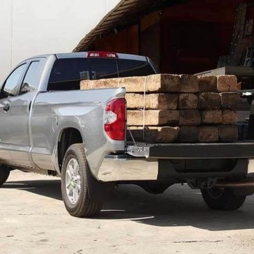 2017 Toyota Tundra bed loaded with wood
