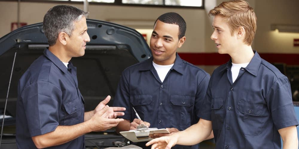 Three shop mechanics
