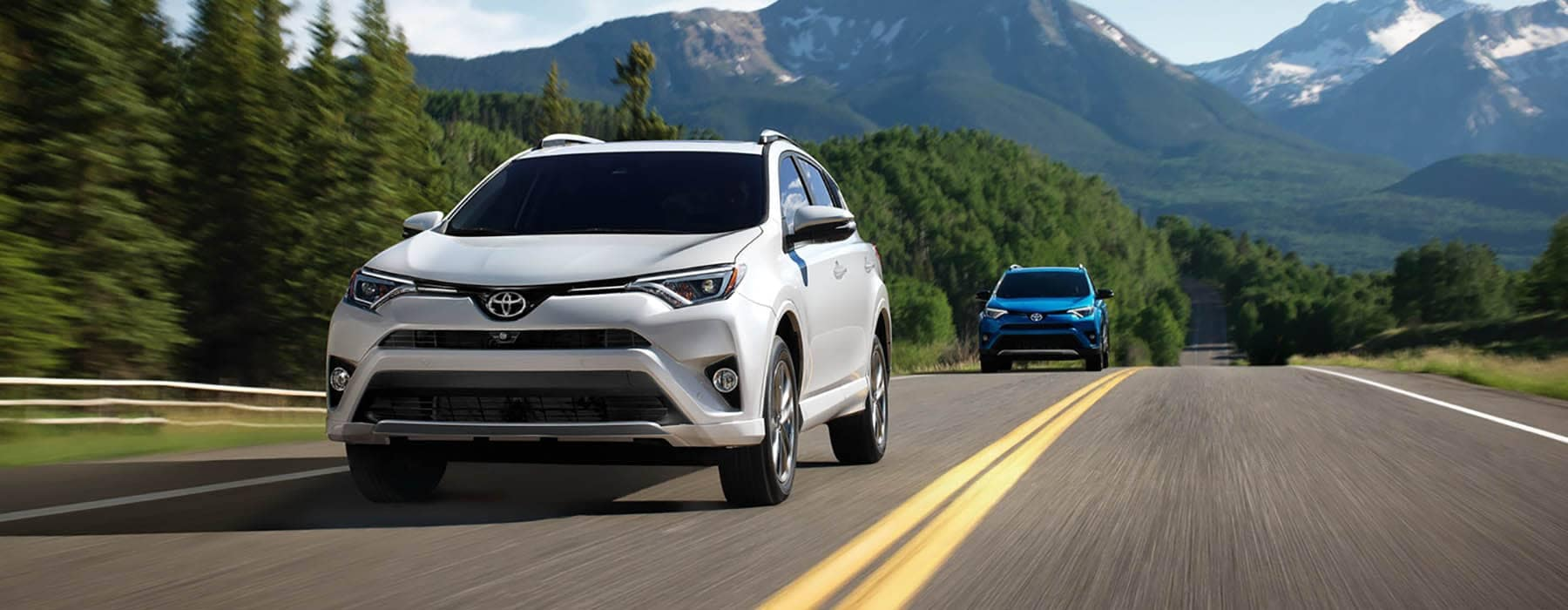 2018 Toyota RAV4 models driving through the mountains