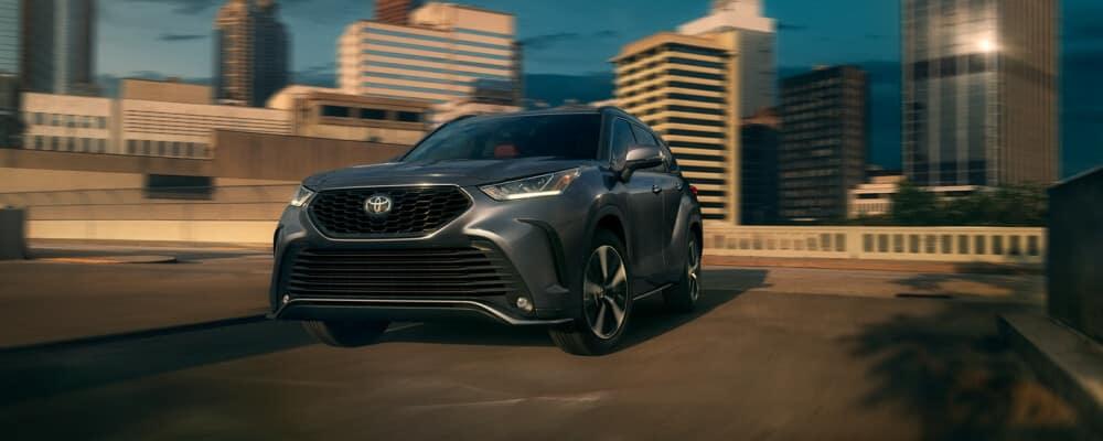 2021 Toyota Highlander driving around a corner