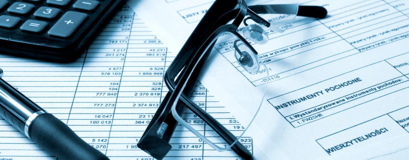 car finance paperwork with calculator and glasses