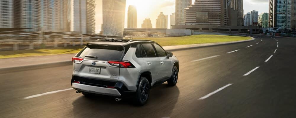 2021 Toyota RAV4 driving towards city on highway