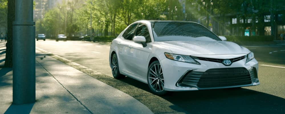 2021 toyota camry parked on the city street